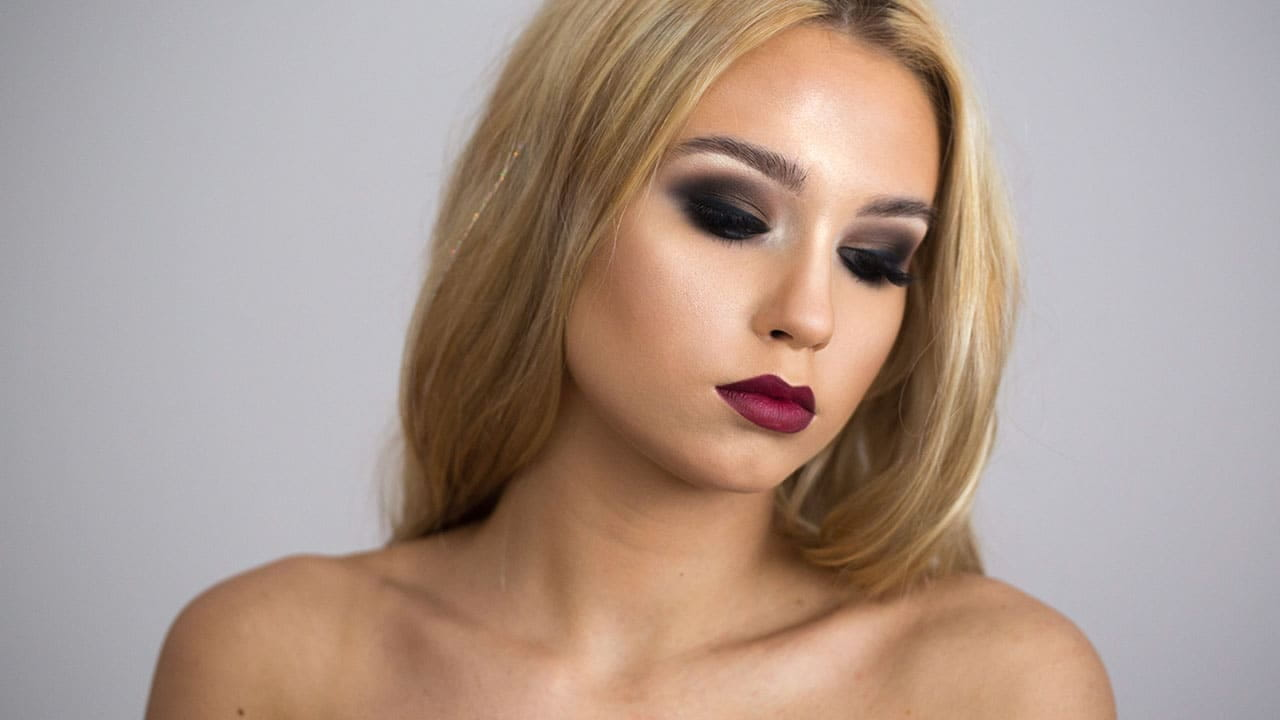 Girl with bold red lips and dark eye makeup